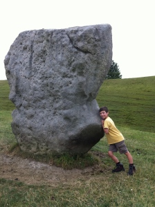Declan tries to push a stone over