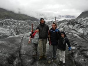 All four of us on a glacier in Iceland