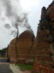Firing the brick kiln.