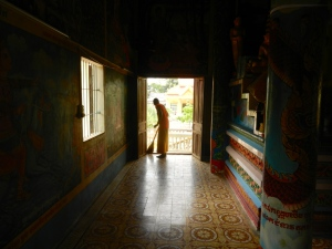 Novice monk at work.
